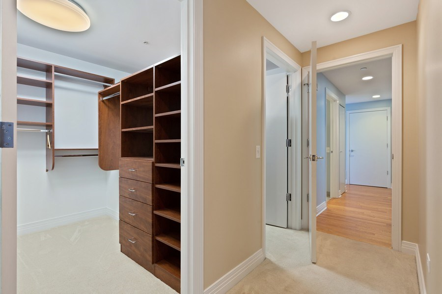 Real Estate Photography - 600 N Lake Shore, Unit 3304, Chicago, IL, 60611 - Master Bedroom Closet