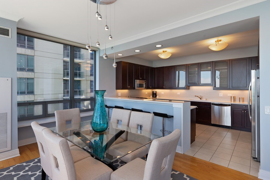 Real Estate Photography - 600 N Lake Shore, Unit 3304, Chicago, IL, 60611 - Kitchen/Dining