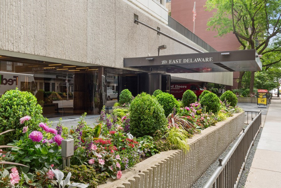 Real Estate Photography - 200 E. Delaware Place, Unit 15A, Chicago, IL, 60611 - Gorgeous Planters at Inviting Front Entrance