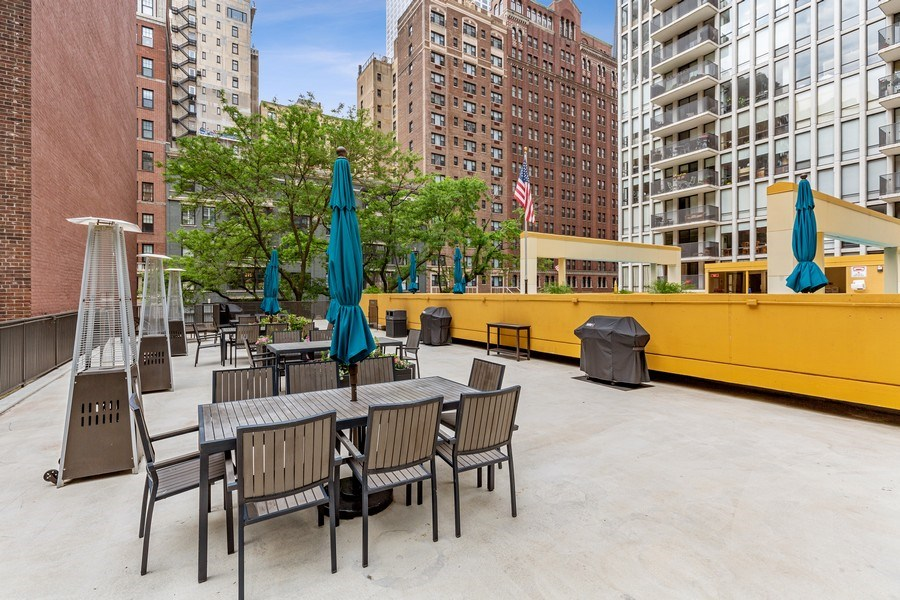 Real Estate Photography - 200 E. Delaware Place, Unit 15A, Chicago, IL, 60611 - Patio Area with Gas Grills