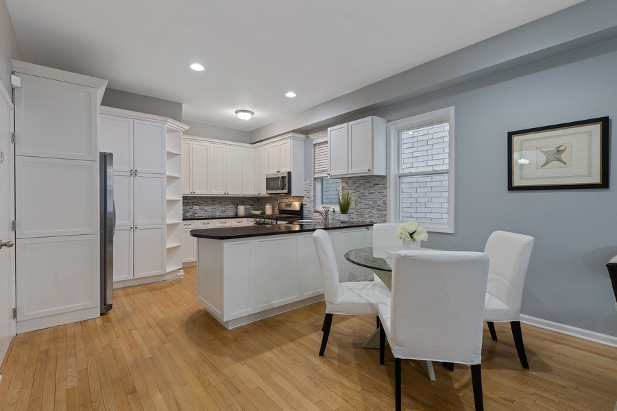 Real Estate Photography - 3645 N Wayne, Unit A, Chicago, IL, 60613 - Kitchen / Dining Room