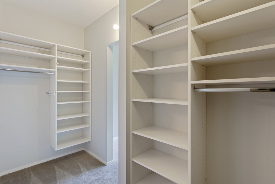 Real Estate Photography - 130 S Canal St, Unit 803, Chicago, IL, 60606 - Master Bedroom Closet