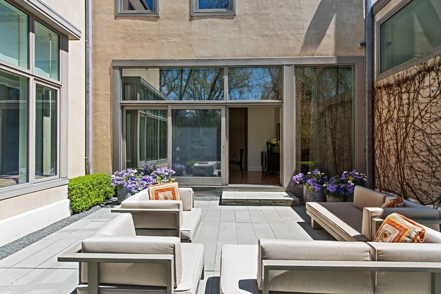 Real Estate Photography - 905 Sunset Road, Winnetka, IL, 60093 - Entertainment Patio off Dining Room