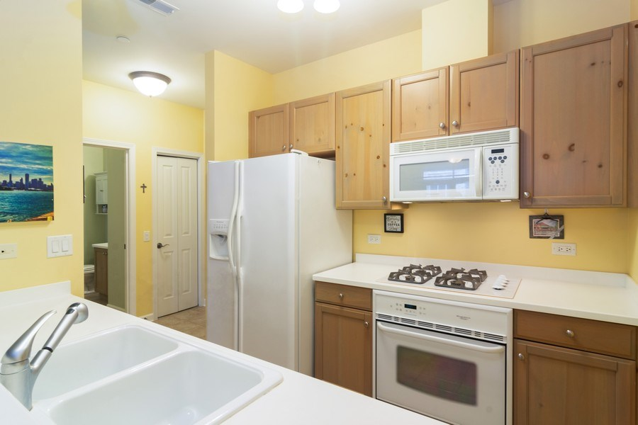 Real Estate Photography - 151 Wing St #309, Arlington Heights, IL, 60005 - Kitchen