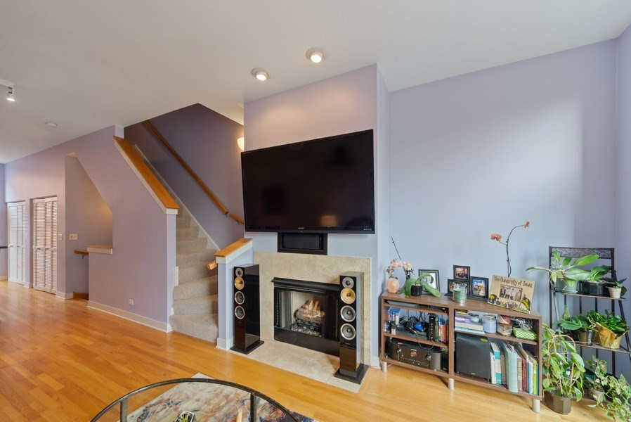 Real Estate Photography - 2338 W Wolfram, Chicago, IL, 60618 - Living room with gas fireplace