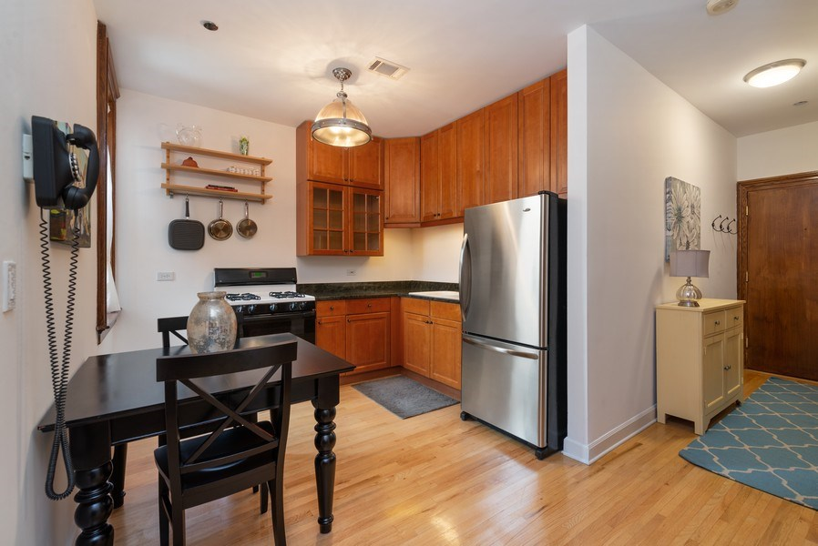 Real Estate Photography - 550 W Surf St, Unit 519, Chicago, IL, 60657 - Kitchen