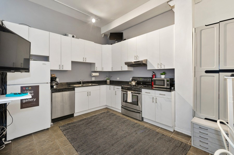 Real Estate Photography - 2418 W Bloomingdale Avenue, Unit 102, Chicago, IL, 60647 - Kitchen