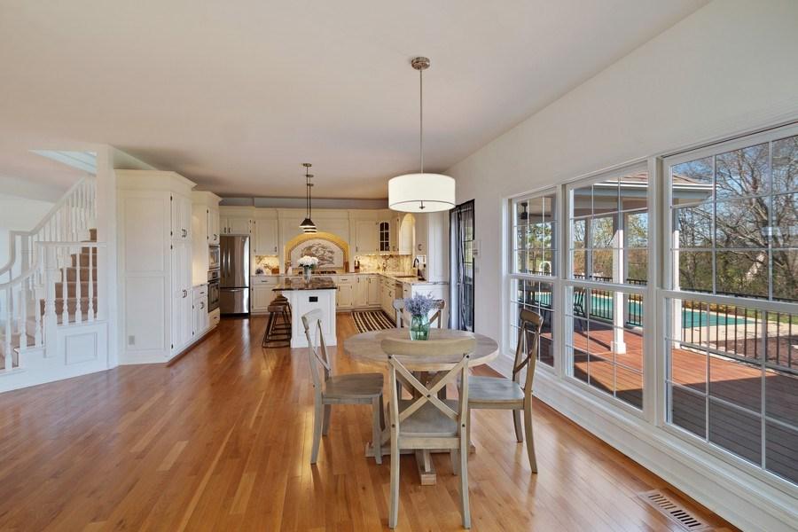 Real Estate Photography - W1186 Trieste Dr, Lake Geneva, WI, 53147 - Kitchen/Eating Area/Deck