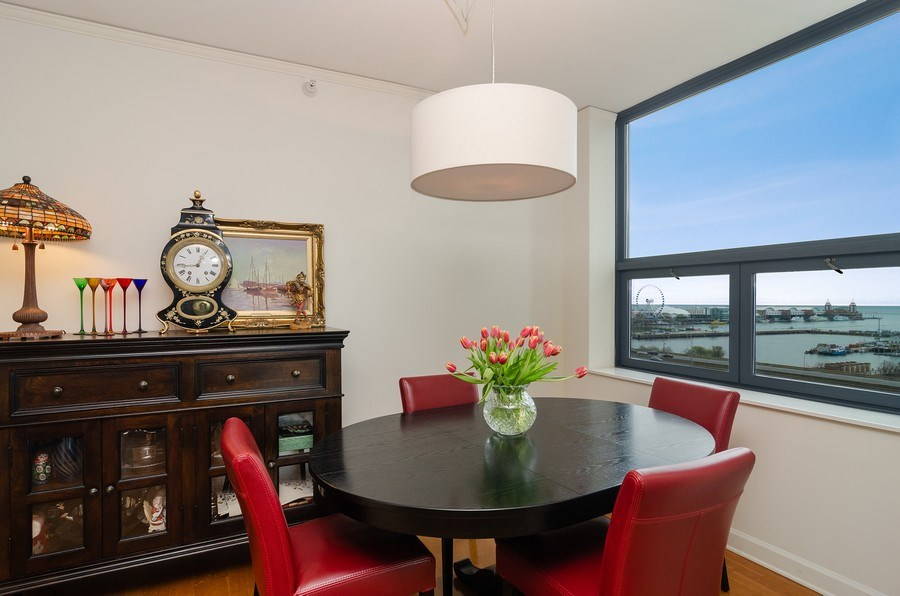 Real Estate Photography - 201 N Westshore Dr, Unit 1102, Chicago, IL, 60601 - Dining Room