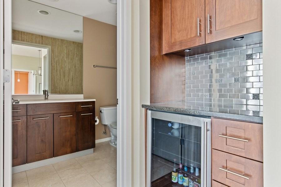 Real Estate Photography - 240 E. Illinois Street, Unit #2704, Chicago, IL, 60611 - Dry Bar with Beverage Fridge