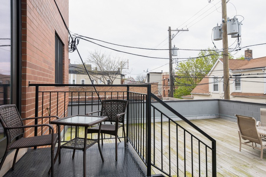 Real Estate Photography - 2550 W Fullerton Ave Unit 2D, Chicago, IL, 60647 - Balcony