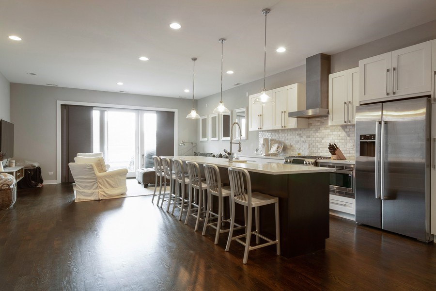 Real Estate Photography - 2550 W Fullerton Ave Unit 2D, Chicago, IL, 60647 - Kitchen / Living Room