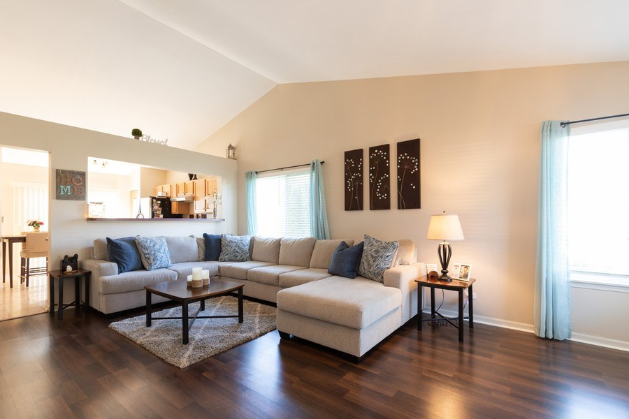 Real Estate Photography - 770 S Providence, Round Lake, IL, 60073 - LARGE Sun-lit Living Room with GORGEOUS Floors!