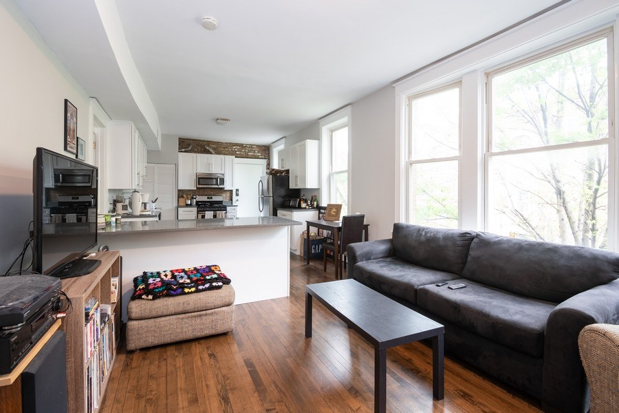 Real Estate Photography - 901 N Francisco Ave, Chicago, IL, 60622 - Living Room / Kitchen Unit 2R