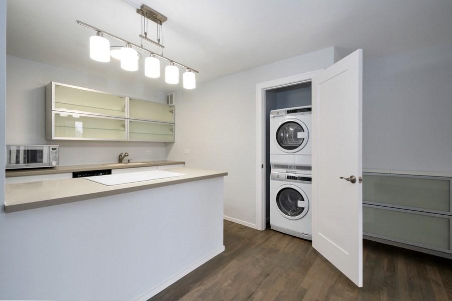 Real Estate Photography - 100 E Walton St, #18A, Chicago, IL, 60611 - Laundry Closet