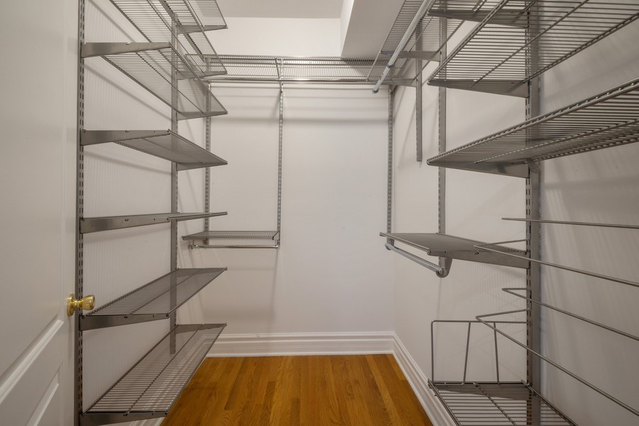 Real Estate Photography - 1352 W Bryn Mawr Ave., #1, Chicago, IL, 60660 - Master Bedroom Closet