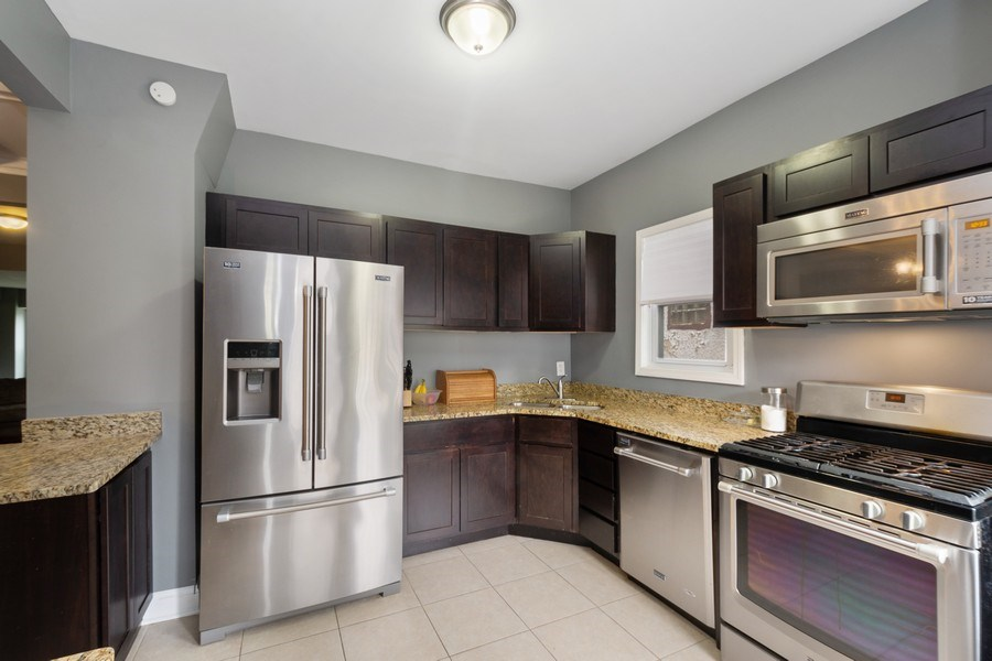 Real Estate Photography - 939 N Lorel Ave, Chicago, IL, 60651 - Kitchen