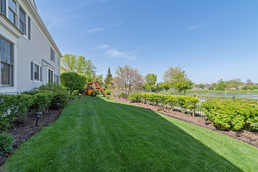 Real Estate Photography - 2200 Fielding, Glenview, IL, 60026 - Gorgeous yard with views of pond!