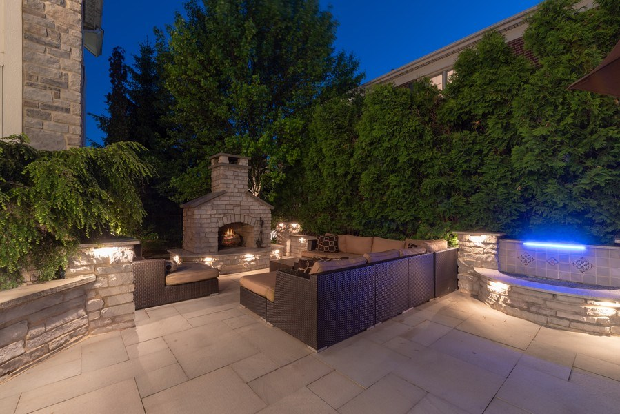 Real Estate Photography - 2200 Fielding, Glenview, IL, 60026 - Patio with fireplace and waterfall
