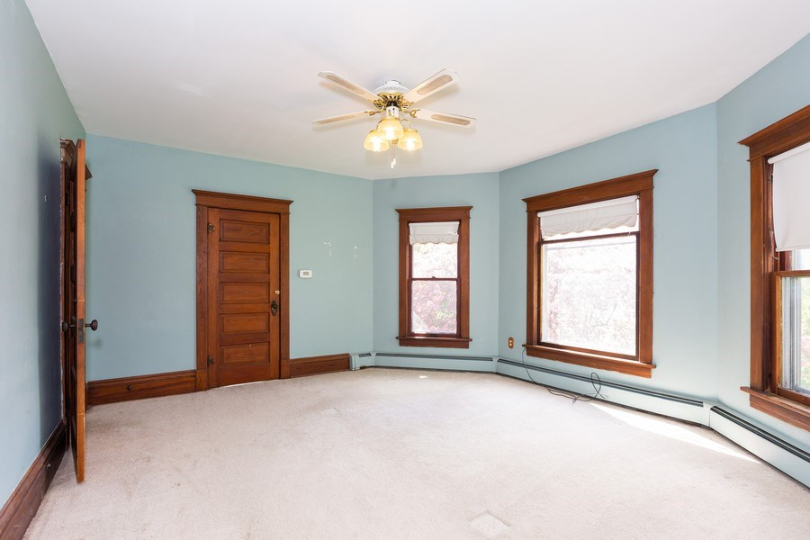 Real Estate Photography - 307 Monroe St, Gardner, IL, 60424 - Master Bedroom with shared, en-suite bathroom
