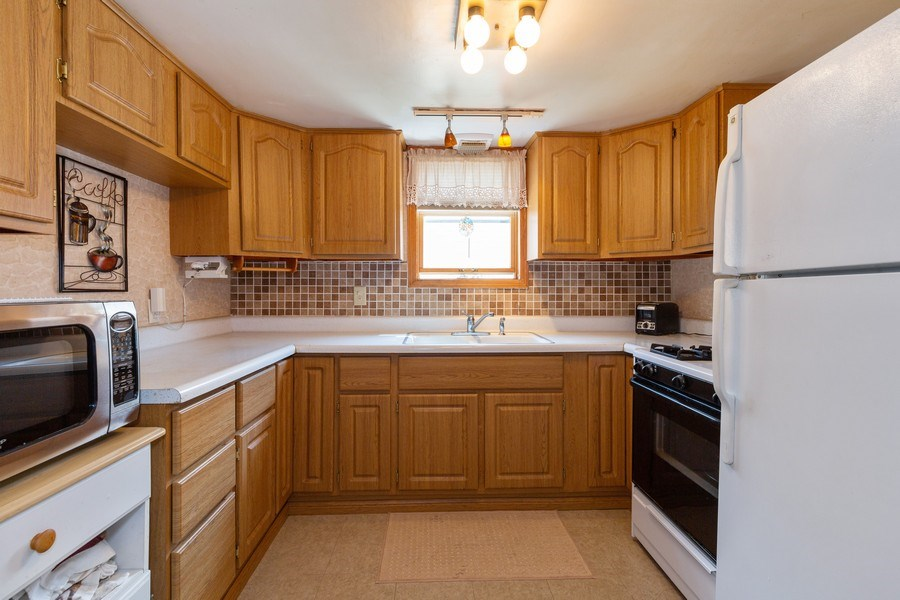 Real Estate Photography - 4548 N. Newland, Harwood Heights, IL, 60706 - Kitchen
