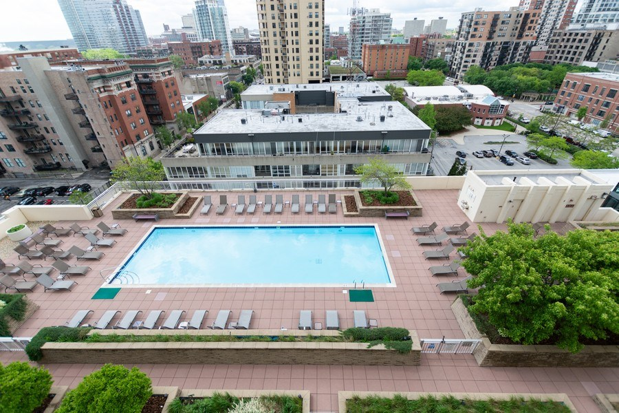 Real Estate Photography - 1400 S. Michigan Ave, Unit 1108, Chicago, IL, 60605 - Pool view from balcony