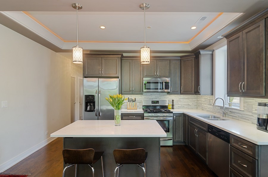 Real Estate Photography - 3104 N Kimball, Unit 2N, Chicago, IL, 60618 - Kitchen