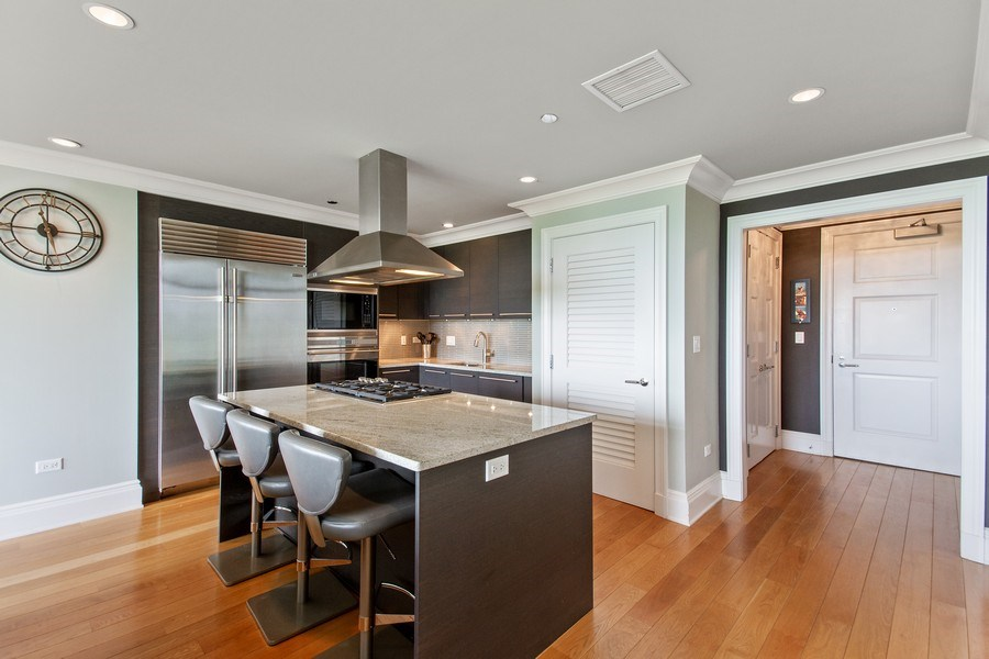 Real Estate Photography - 2550 N Lakeview, N703, Chicago, IL, 60614 - Kitchen Island Breakfast Bar
