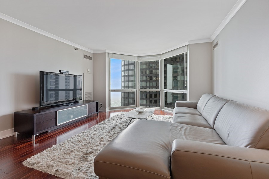 Real Estate Photography - 195 Harbor Dr #2405, Chicago, IL, 60601 - Living Room