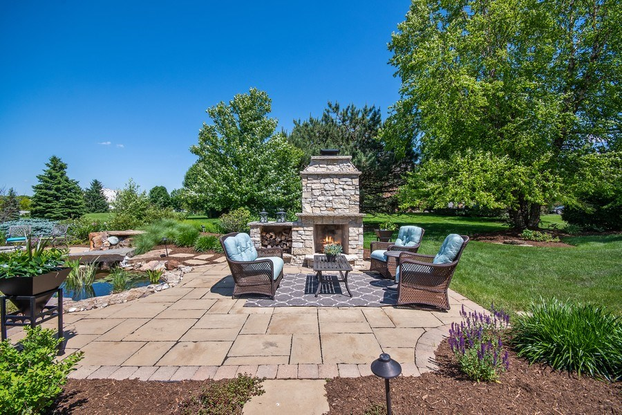 Real Estate Photography - 36W746 Whispering Trail, St. Charles, IL, 60175 - Backyard patio with fireplace
