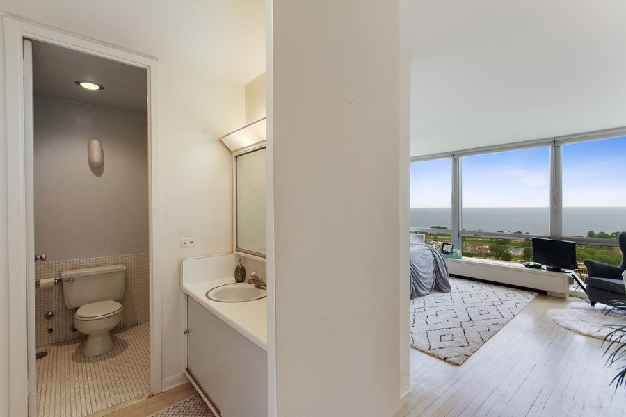 Real Estate Photography - 2400 N Lakeview, Unit 2602, Chicago, IL, 60614 - Master Bed + Ensuite Bathroom