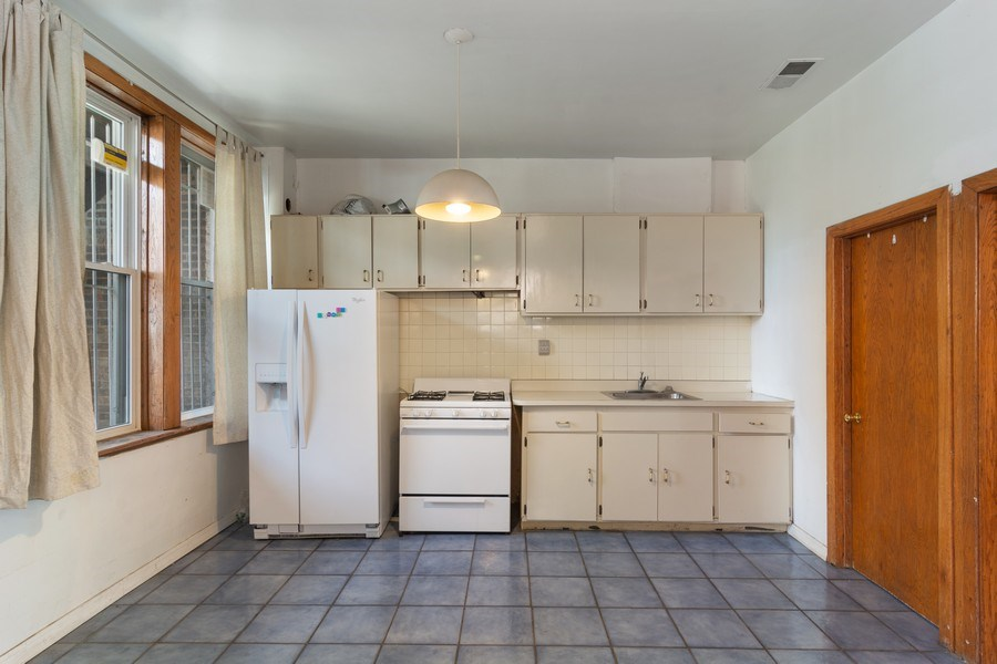 Real Estate Photography - 3110 W Irving Park Rd, Chicago, IL, 60618 - Kitchen