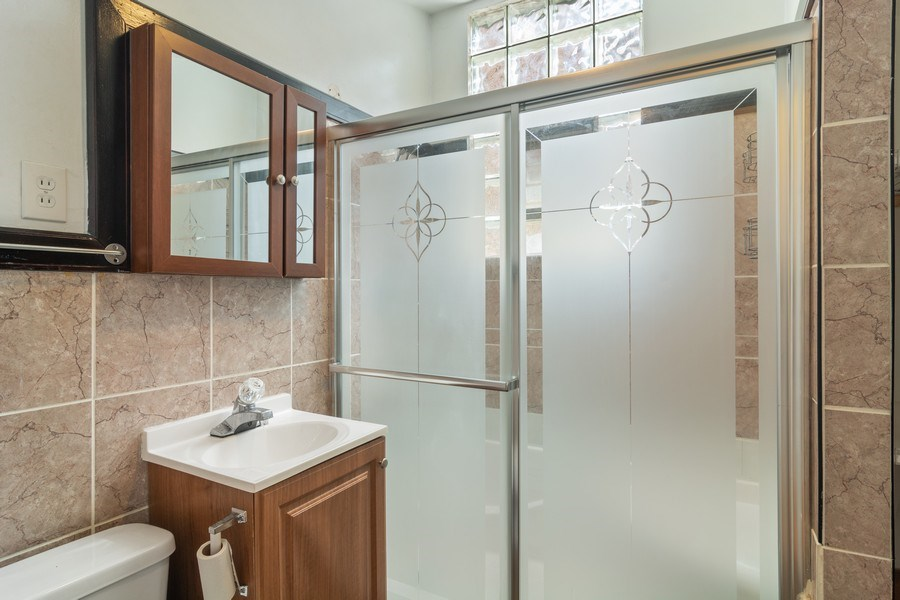 Real Estate Photography - 3110 W Irving Park Rd, Chicago, IL, 60618 - Bathroom