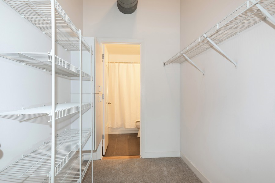 Real Estate Photography - 411 W Ontario, Unit 214, Chicago, IL, 60654 - Master Bedroom Closet
