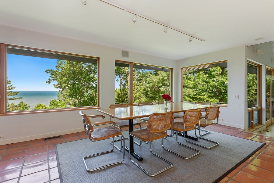 Real Estate Photography - 9475 Lakeview Dr, Bridgman, MI, 49106 - Dining room with full lake views