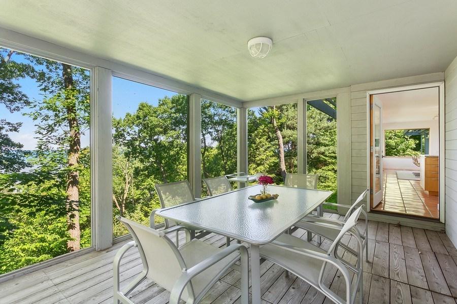 Real Estate Photography - 9475 Lakeview Dr, Bridgman, MI, 49106 - Screened porch off kitchen