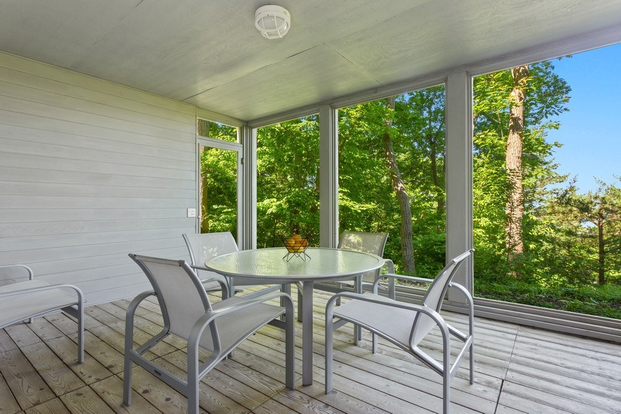 Real Estate Photography - 9475 Lakeview Dr, Bridgman, MI, 49106 - Lower screened porch