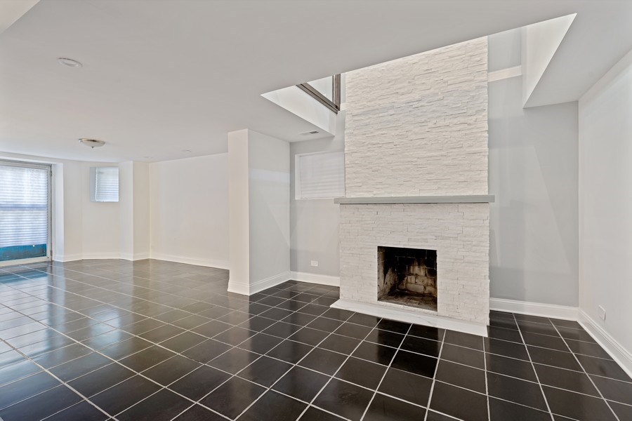 Real Estate Photography - 4008 N Clarendon, Chicago, IL, 60613 - Lower Level Family Room