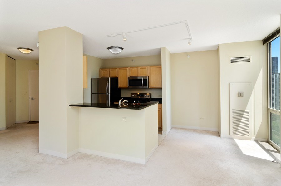 Real Estate Photography - 222 N Columbus Dr, 1902, Chicago, IL, 60601 - Kitchen / Dining Room