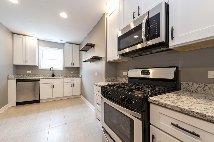Real Estate Photography - 618 N Lotus Avenue, Chicago, IL, 60644 - Kitchen