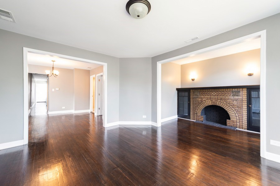 Real Estate Photography - 618 N Lotus Avenue, Chicago, IL, 60644 - Living Room / Dining Room