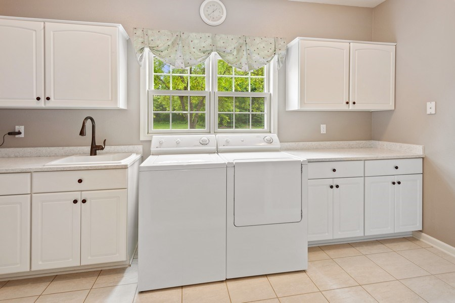 Real Estate Photography - 7005 W Lafayette PL, Mequon, WI, 53092 - Laundry Room