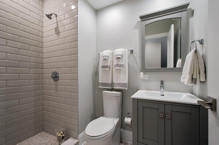Real Estate Photography - 7052 Palma Ln, Morton Grove, IL, 60053 - 1st floor Bathroom