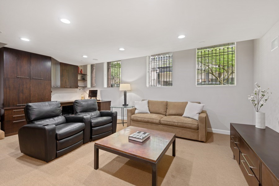 Real Estate Photography - 31 E Elm, 1B, Chicago, IL, 60611 - Family room in the lower level