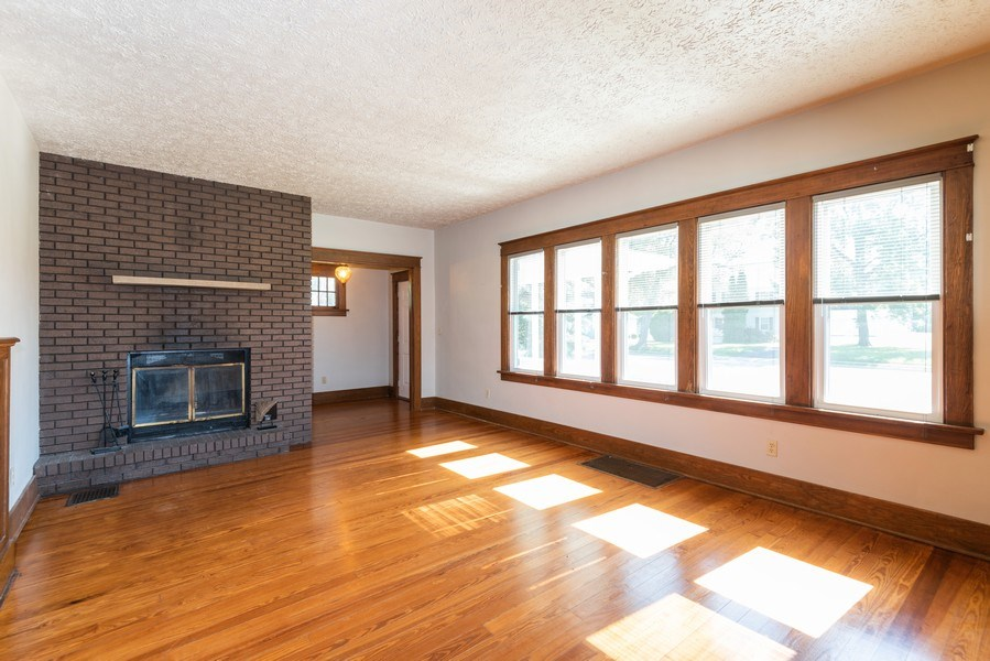Real Estate Photography - 907 N Main Street, Watervliet, MI, 49098 - Living Room Fireplace