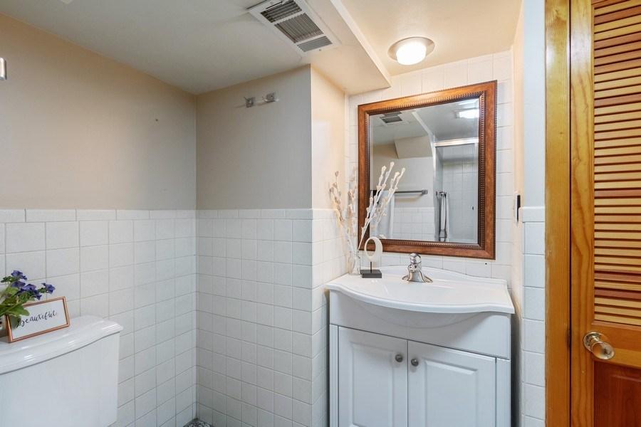 Real Estate Photography - 530 Cambridge Rd, Des Plaines, IL, 60016 - Full Bath in Basement