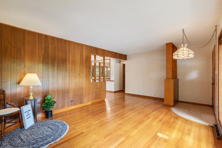 Real Estate Photography - 530 Cambridge Rd, Des Plaines, IL, 60016 - Living Room / Dining Room