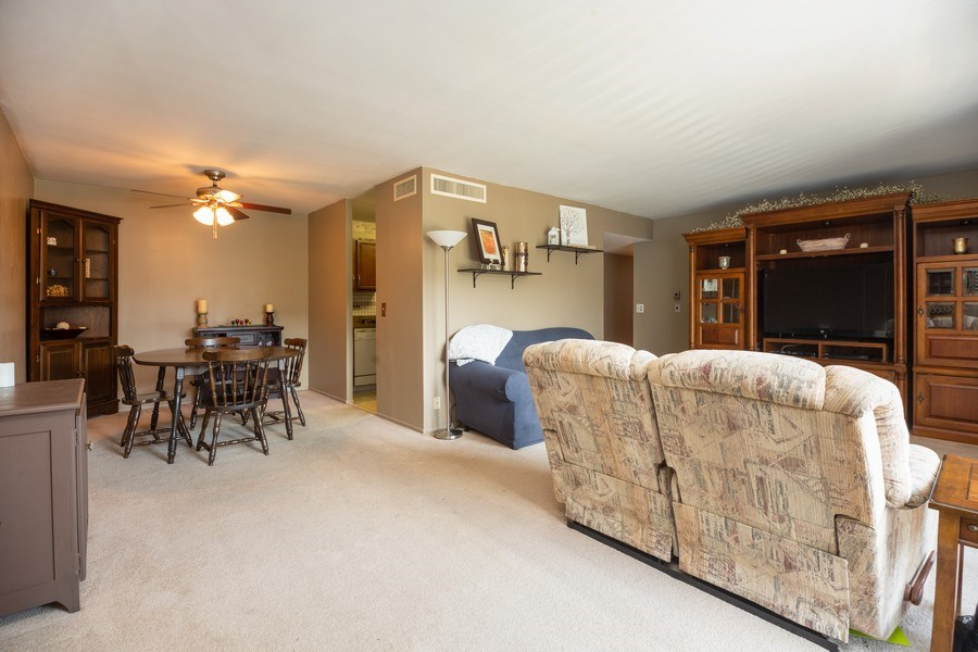 Real Estate Photography - 898 Wellington Ave, #209, Elk Grove Village, IL, 60007 - Living Room / Dining Room
