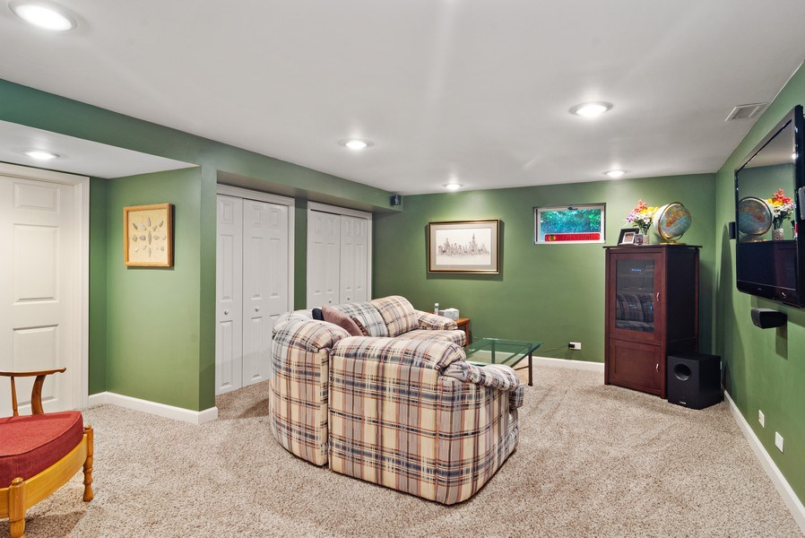 Real Estate Photography - 730 E Hawthorne, Arlington Heights, IL, 60004 - 2nd Family Room in Basement. HUGE Storage Area as