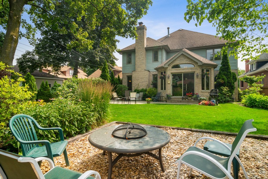 Real Estate Photography - 18 S Louis St, Mount Prospect, IL, 60056 - Back Yard Garden - Firepit Area to Home